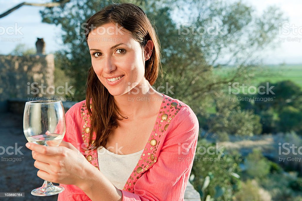 Young woman with glass of wine, portrait royalty-free stock photo
