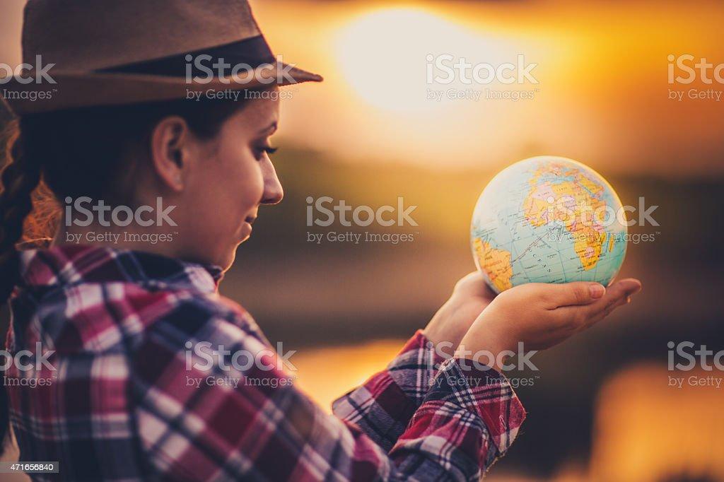 Young woman with globe Young woman with globe 2015 Stock Photo