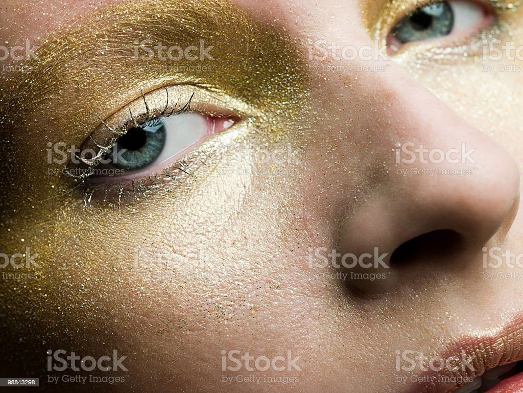 Young woman with gold make up on face royalty-free stock photo