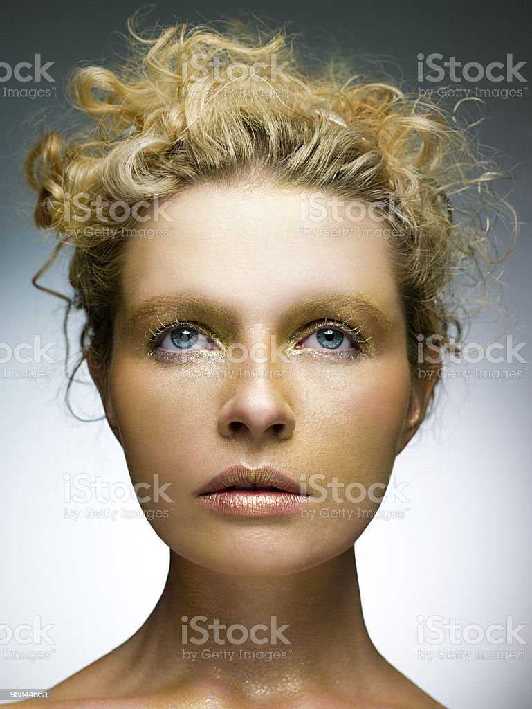 Young woman with gold make up on face royalty free stockfoto