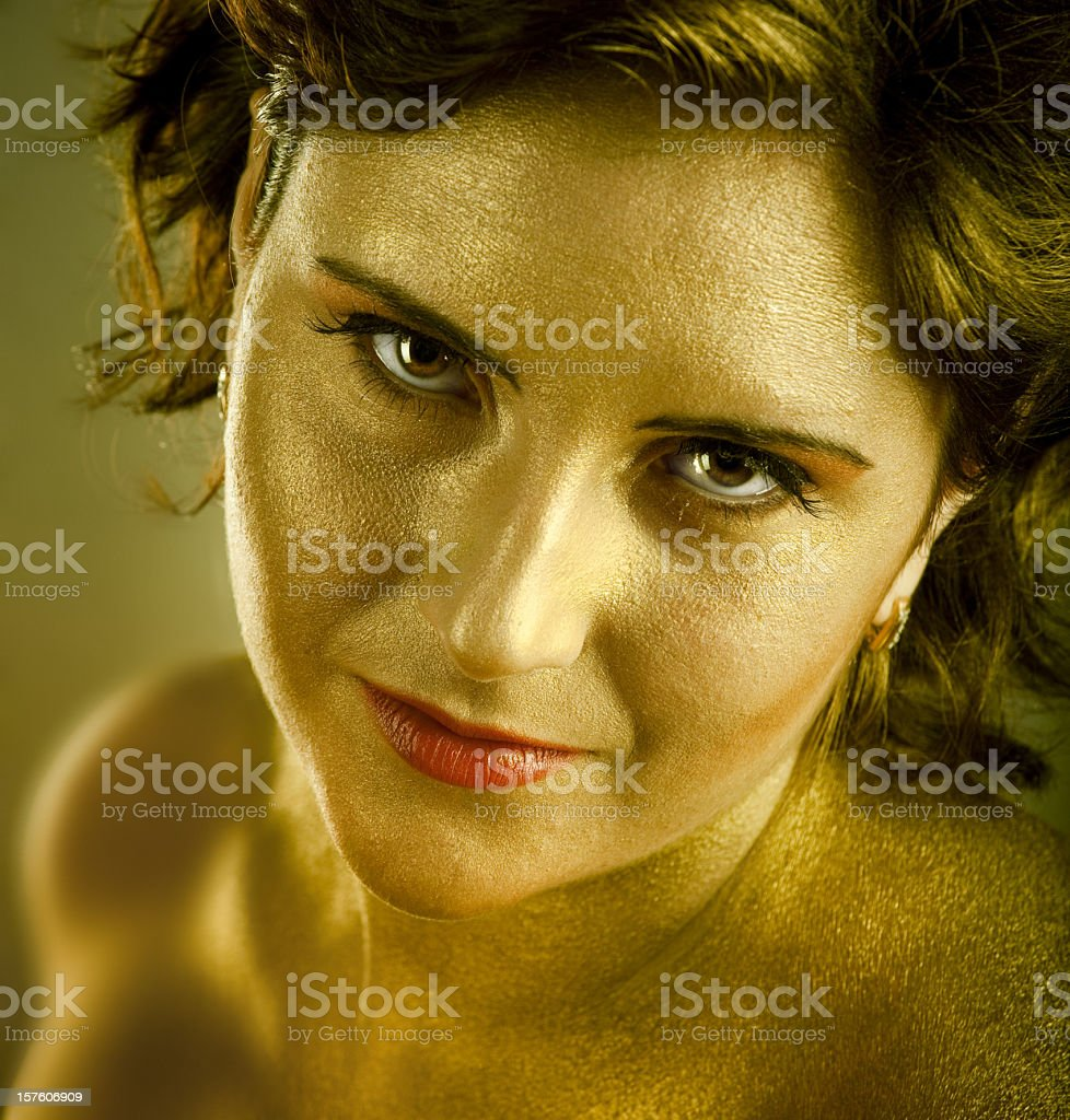 Young woman with gold skin royalty-free stock photo