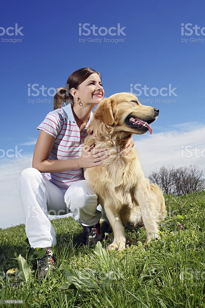 Young woman with  golden retriever.. royalty-free stock photo