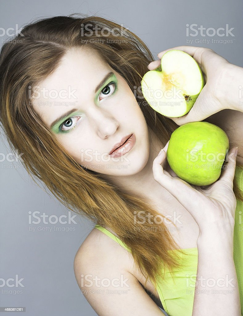 Young woman with green apple royalty-free stock photo