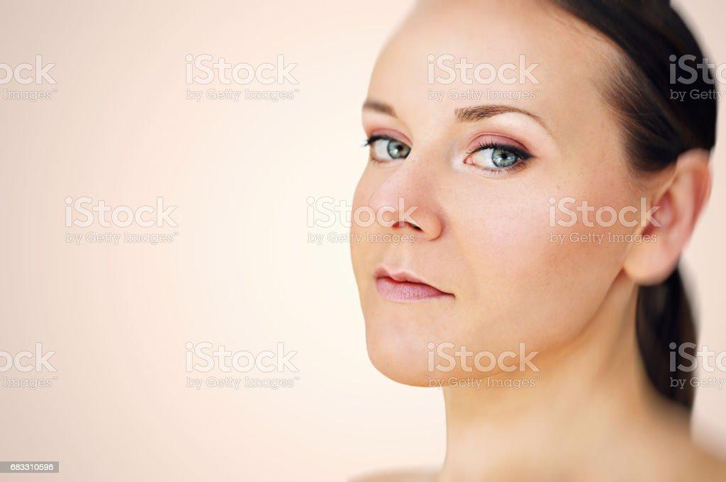Young woman with green eyes wearing minimal makeup. royaltyfri bildbanksbilder