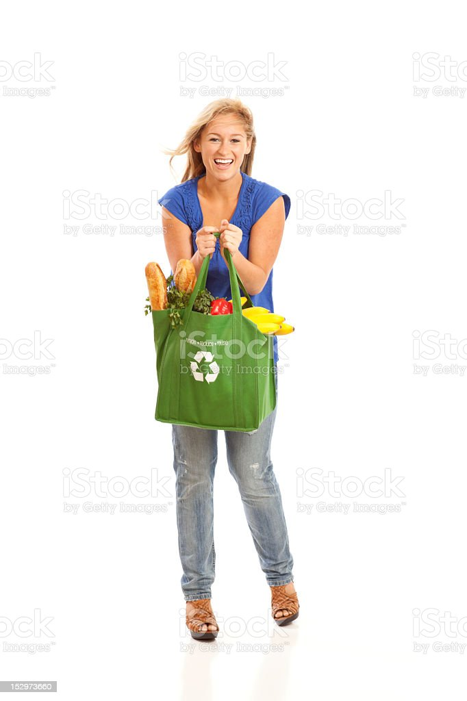 Young woman with green recycled grocery bag royalty-free stock photo