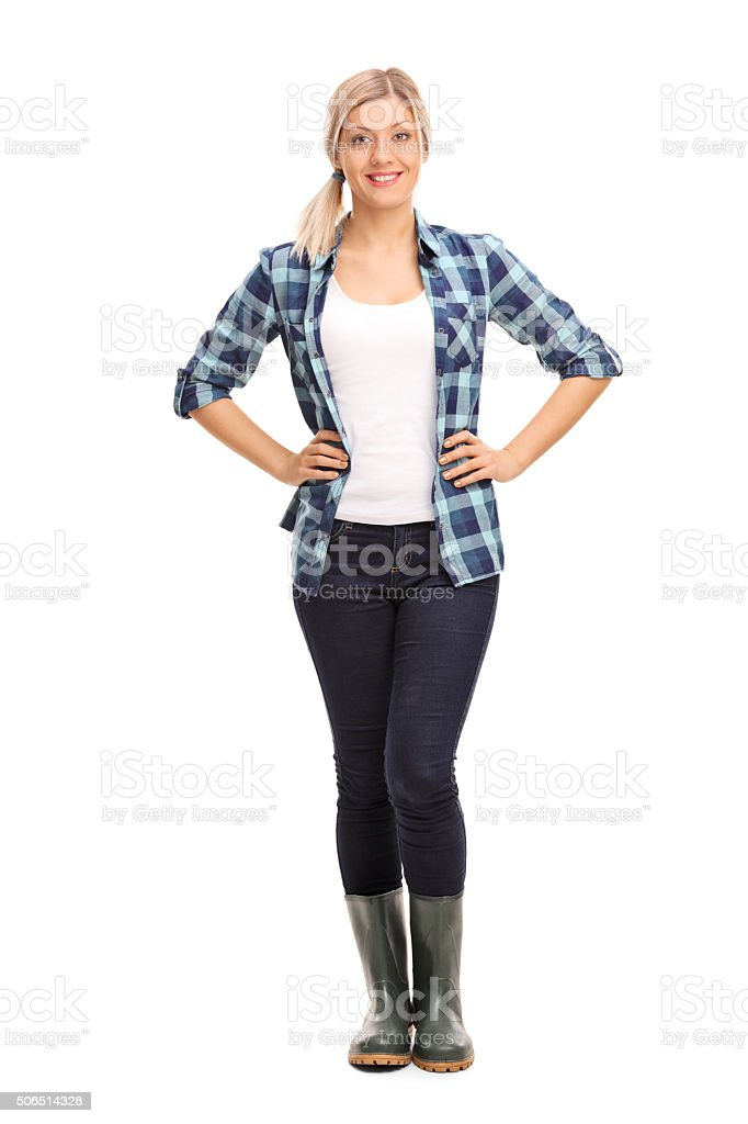 Young woman with green rubber boots stock photo