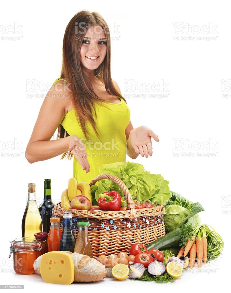Young woman with grocery products isolated on white royalty-free stock photo