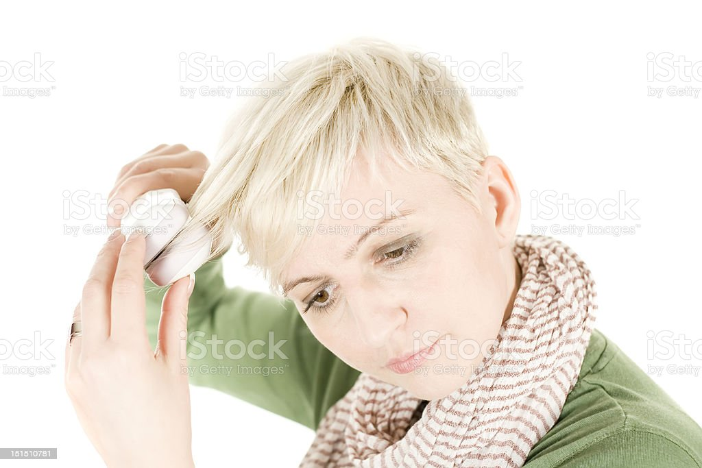 Young woman with hair iron stock photo