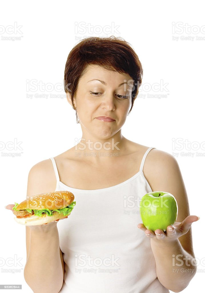 Young woman with hamburger and apple royalty-free stock photo