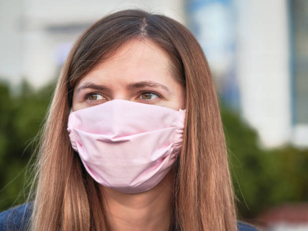 young woman with hand made face nose mouth mask portrait, can be used during coronavirus covid19 outbreak prevention - feito em casa imagens e fotografias de stock
