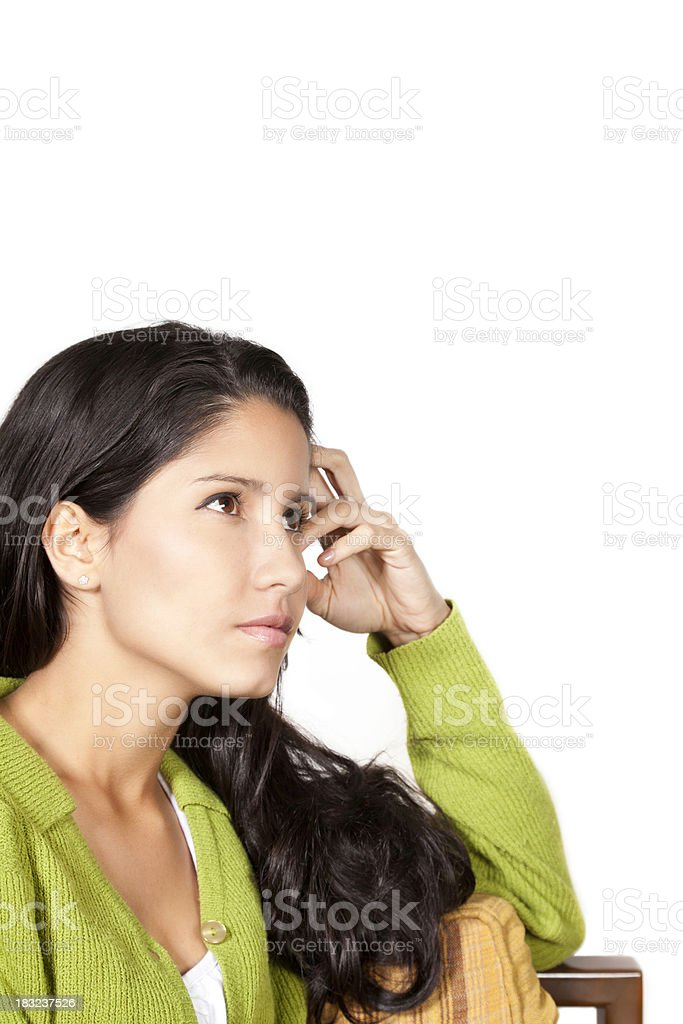 Young Woman With Hand to Head Thinking royalty-free stock photo