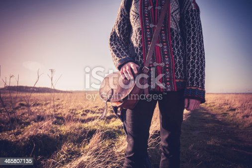 509923232 istock photo Young woman with handbag standing on nature trail 465807135