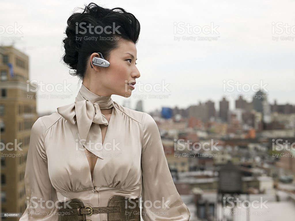 Young woman with hands free device 免版稅 stock photo