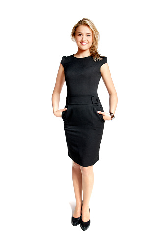 istock Young woman with hands in the pockets of her black dress 153524981