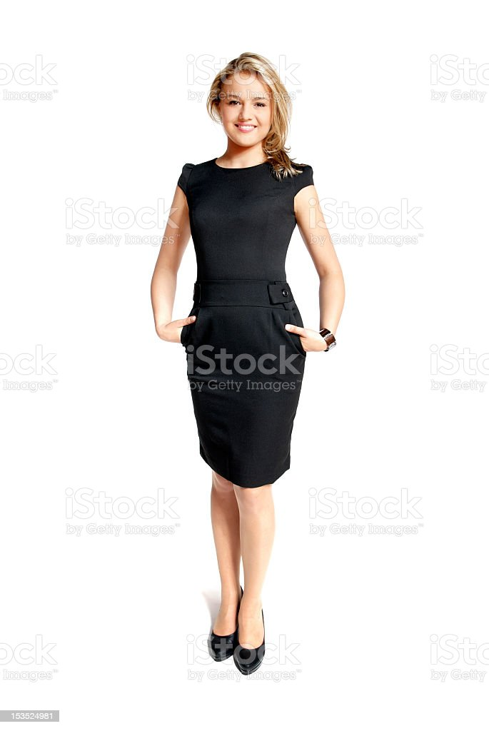 Young woman with hands in the pockets of her black dress stock photo