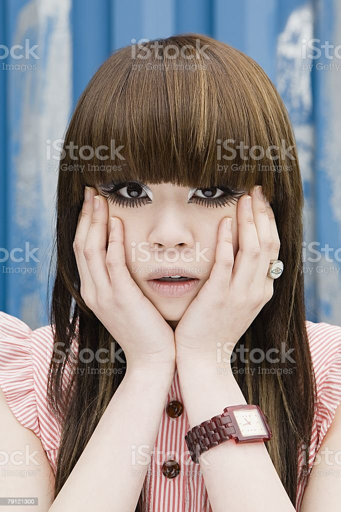 Young woman with hands on her face royalty-free stock photo