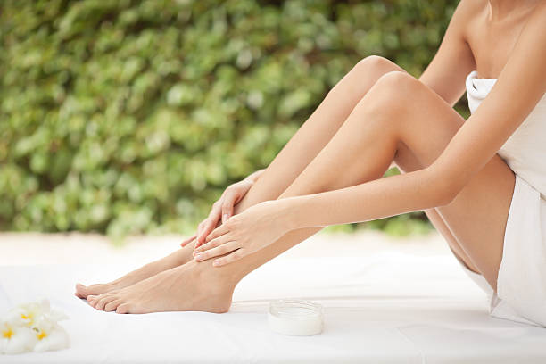 Young woman with hands on legs stock photo