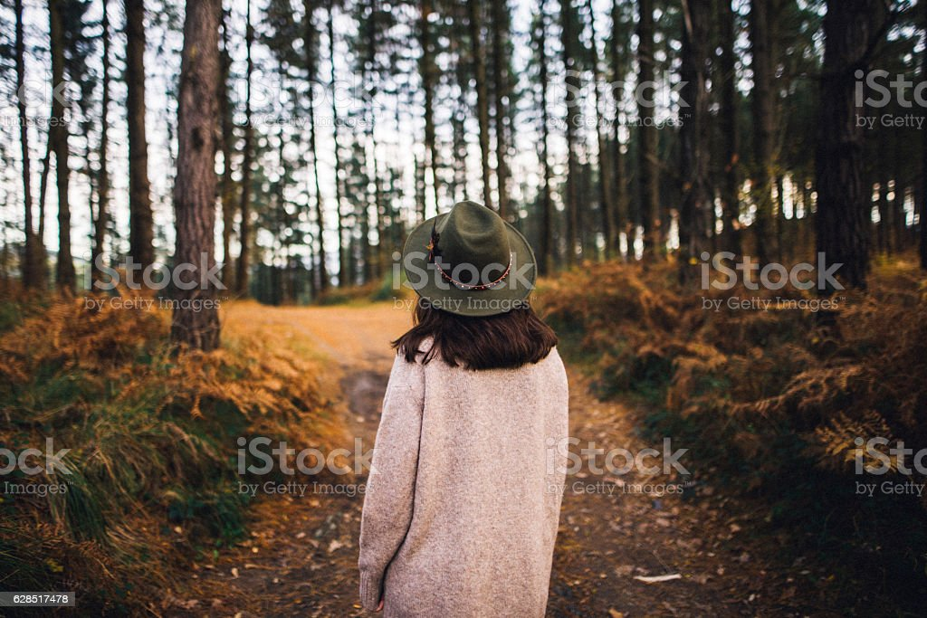 Young woman with hat at forest stock photo