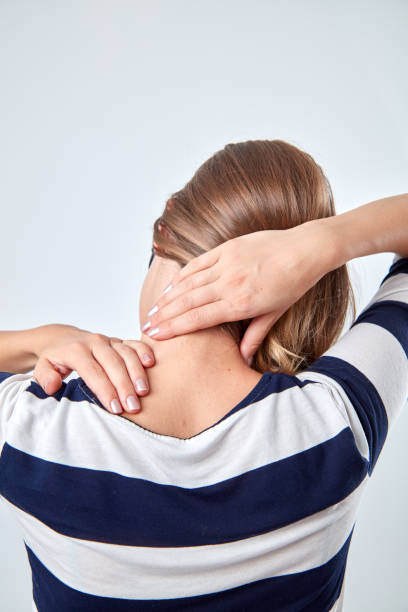 Young woman with headache / pain holding head. stock photo