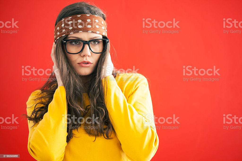 Young woman with headband on red background stock photo