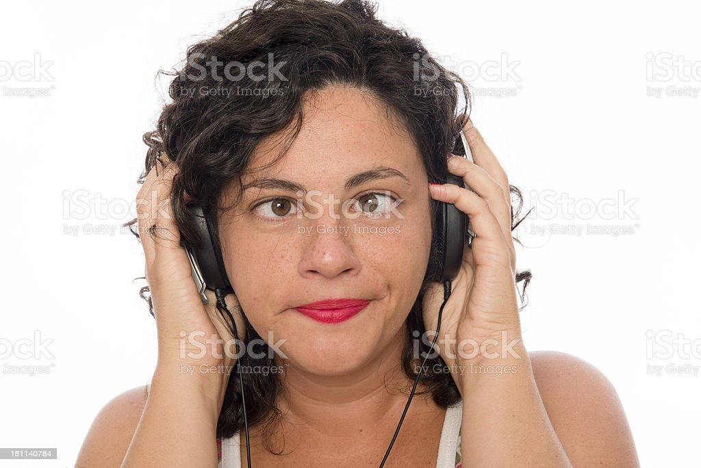 Young Woman with headphones and crossed eyes royalty-free stock photo