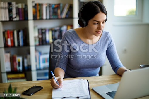 Young woman with headphones working from home