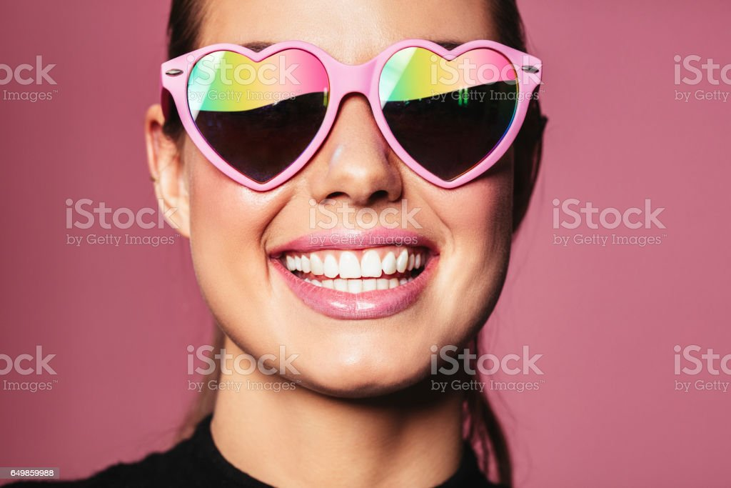 Young woman with heart shaped glasses