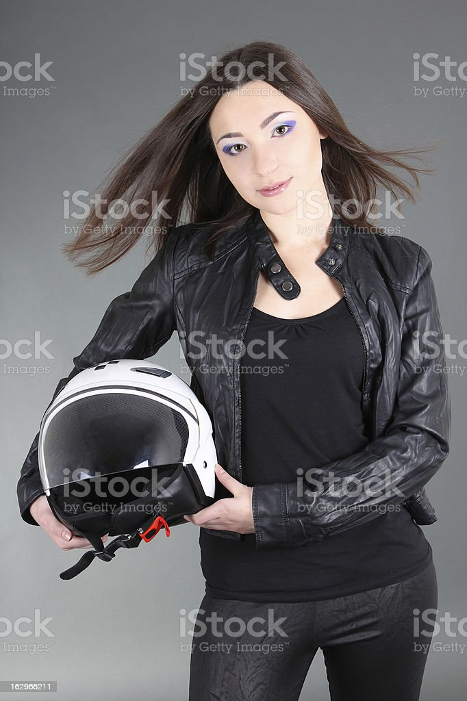 Young woman with helmet in hands royalty-free stock photo