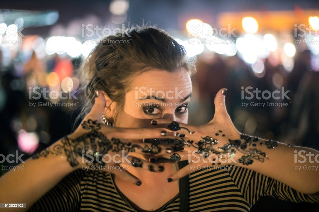 Young woman with Henna tattoo stock photo