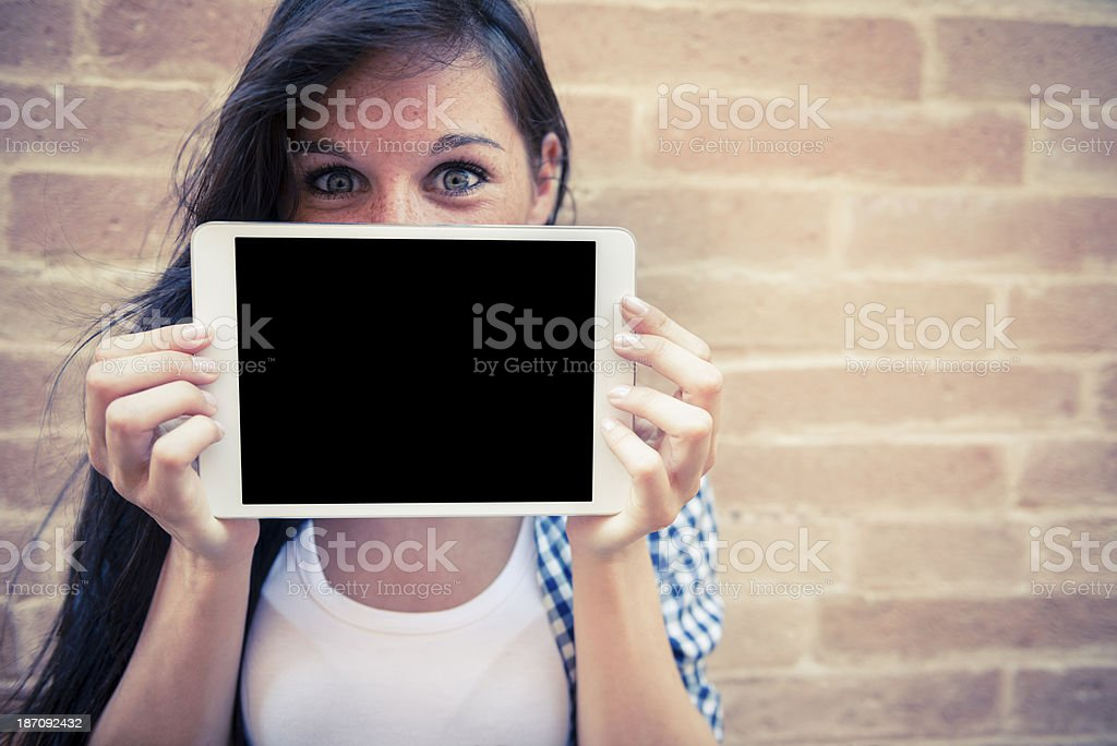 Young woman with her digital tablet stock photo