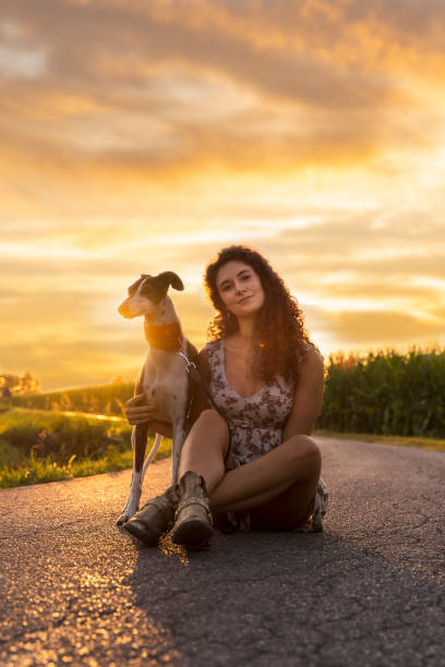 Young woman with her dog sitting picture id1260644593?b=1&k=6&m=1260644593&s=612x612&w=0&h=w3wydm9puv6cemqdrrerdgju72joja5gwxkltjif0gc=