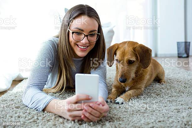 Young woman with her dog using mobile phone at home picture id519709446?b=1&k=6&m=519709446&s=612x612&h=cypqcuxabkf   4pnskyolwwlffg2r6oprdzcuijf38=
