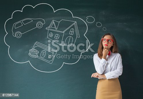 481974106istockphoto Young woman with her dreams 612387144