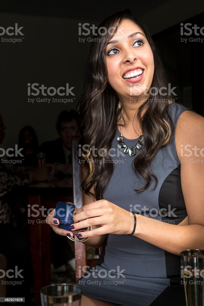 Young woman with her engagement ring royalty-free stock photo