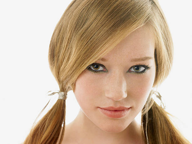 young woman with her hair in pigtails - pigtails stock photos and pictures