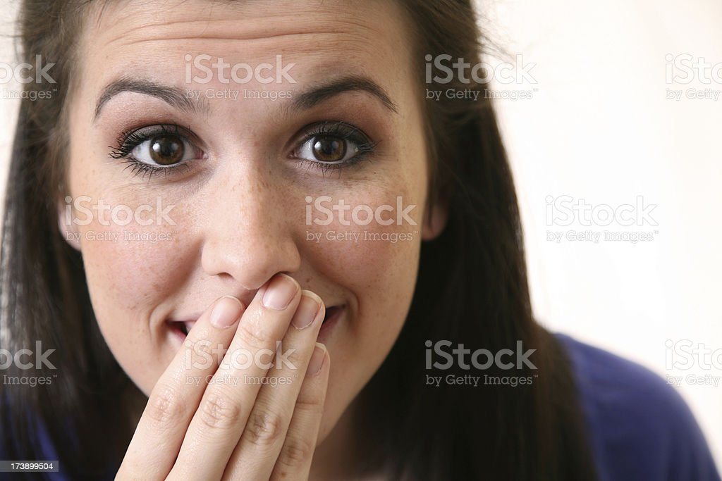 Young Woman With Her Hand to Mouth royalty-free stock photo