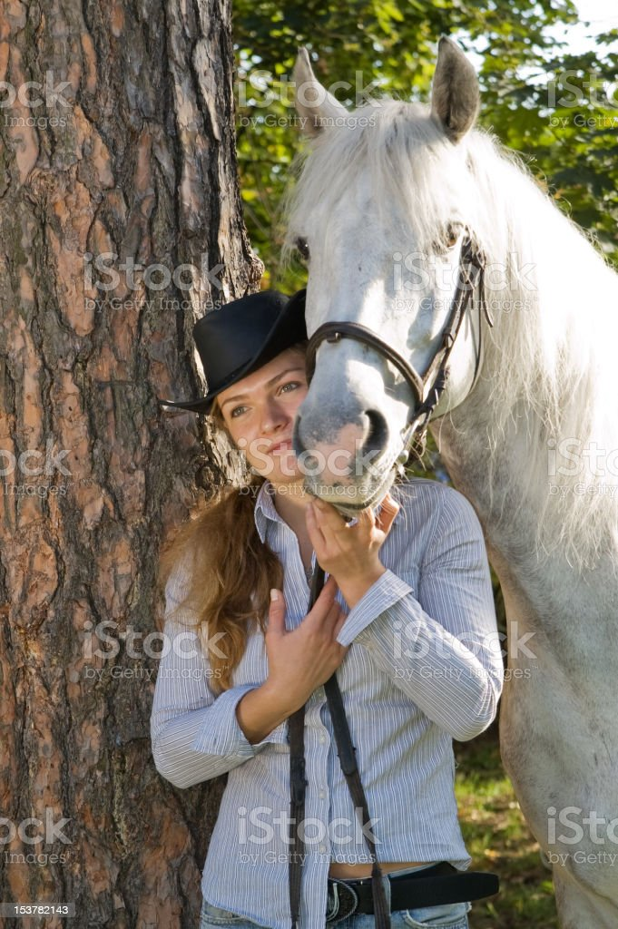 Young woman with her horse royalty-free stock photo