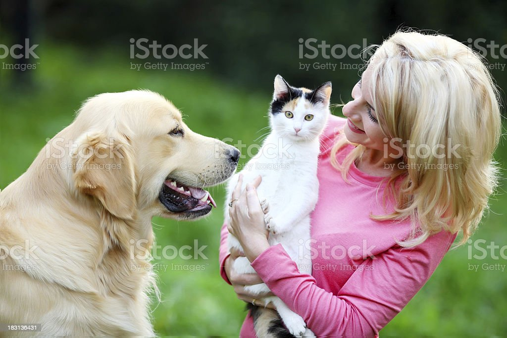 Young woman with her pets. stock photo