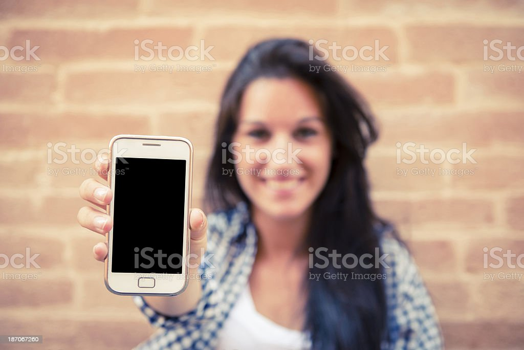 Young woman with her smart phone stock photo
