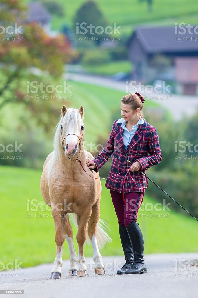 Young woman with horse royalty-free stock photo