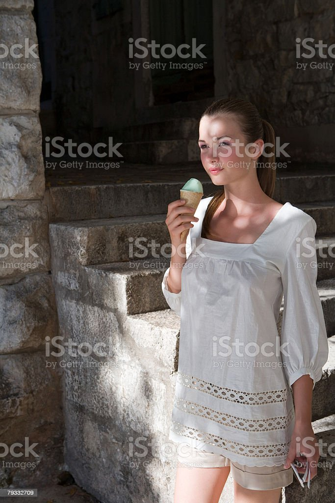 Young woman with ice cream 免版稅 stock photo