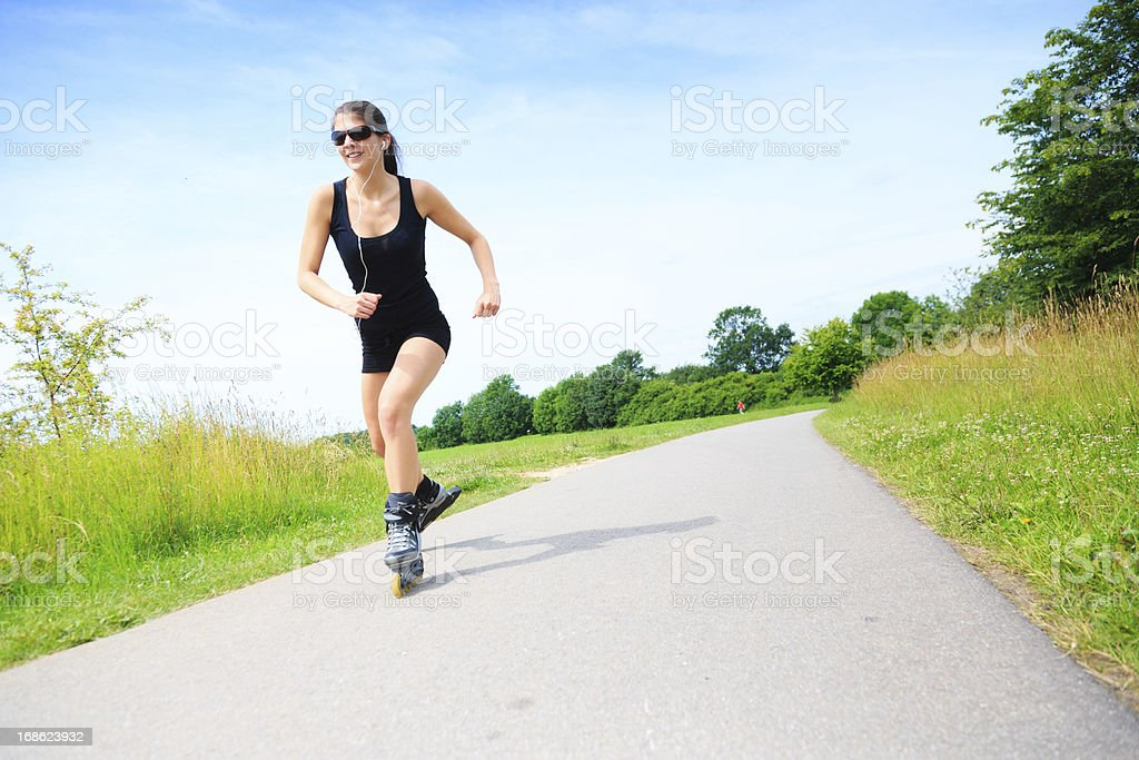 young woman with inline skates royalty-free stock photo