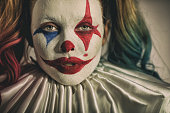 istock Young woman with Joker make-up 1201524998