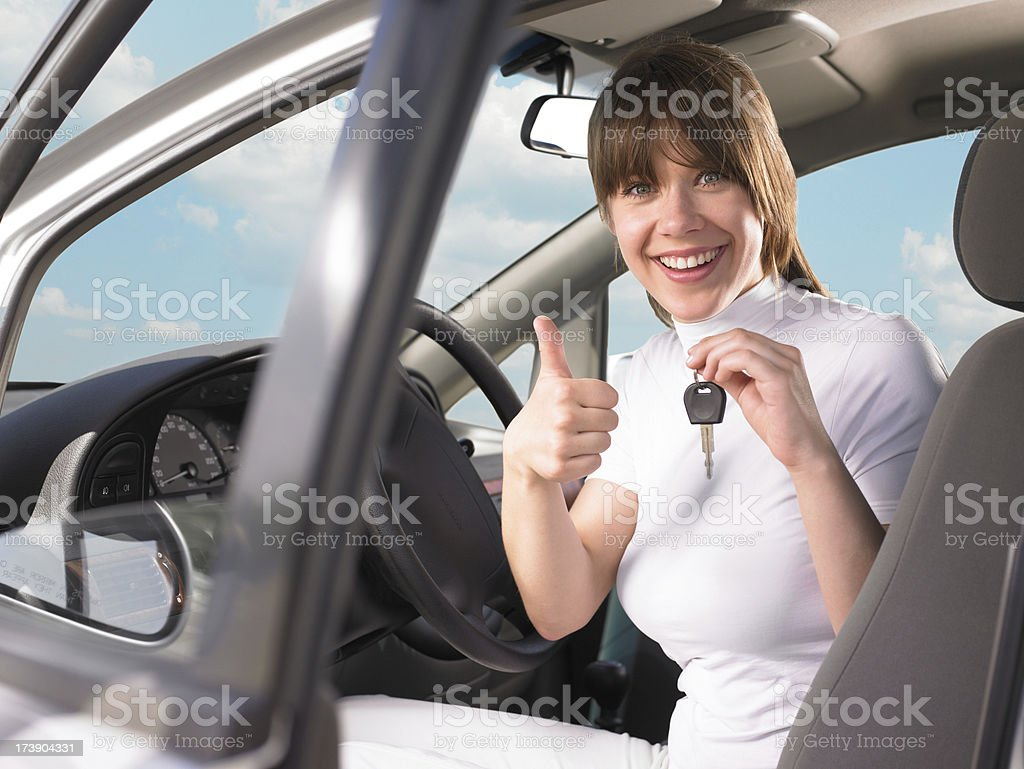 Young woman with keys of new car royalty-free stock photo
