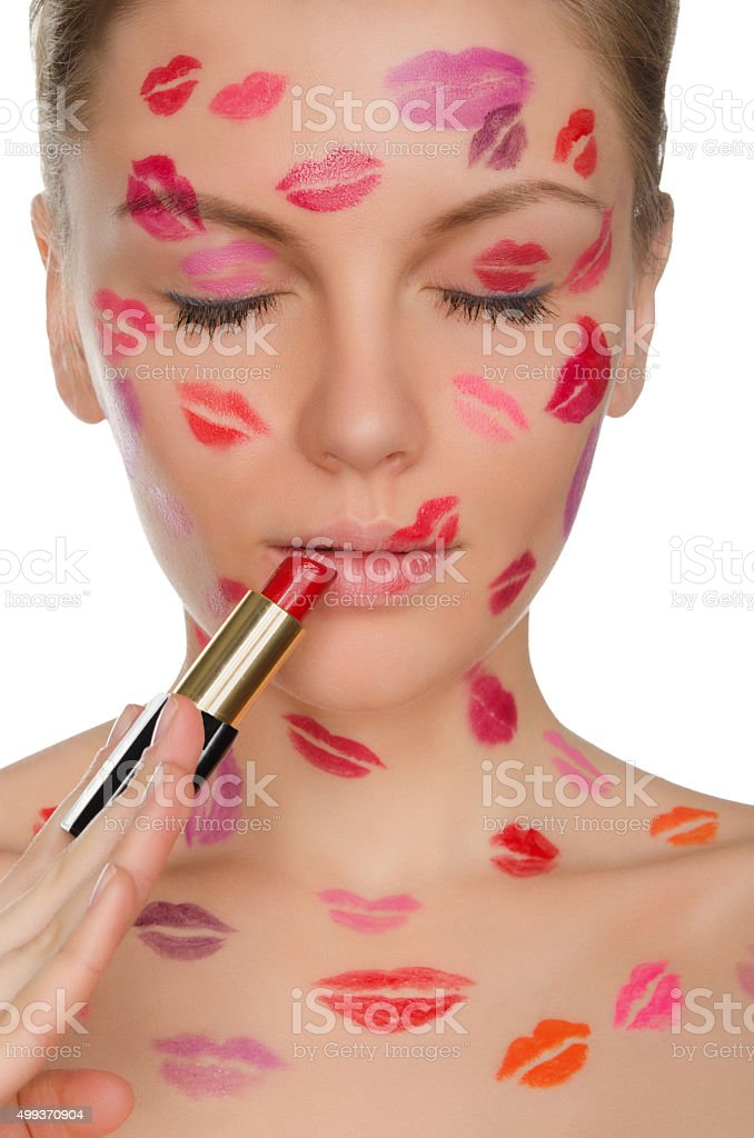 young woman with kisses on face and lipstick stock photo