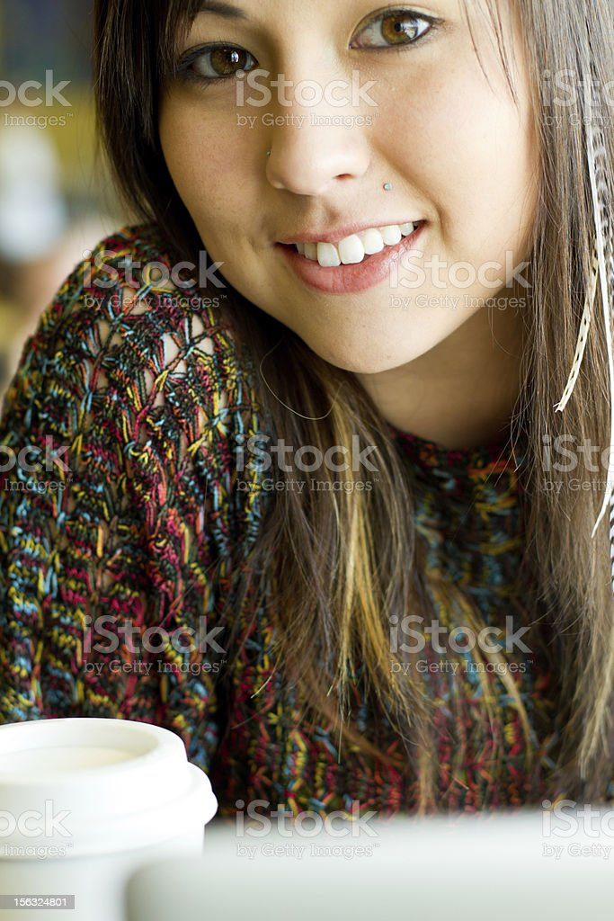 Young Woman with Laptop and To Go Coffee stock photo