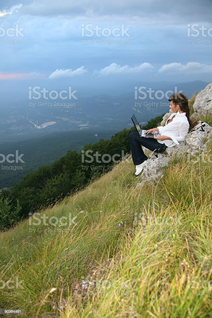 Young woman with lap-top on the mountain royalty-free stock photo