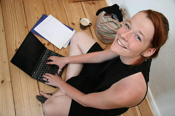 Young woman with laptop smiling stock photo