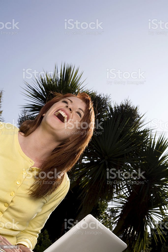 Young woman with laptop working outdoors royalty-free stock photo