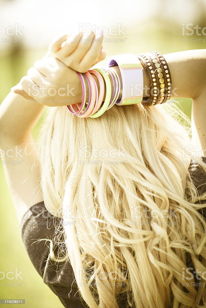 Young woman with long blond hair outdoors royalty-free stock photo